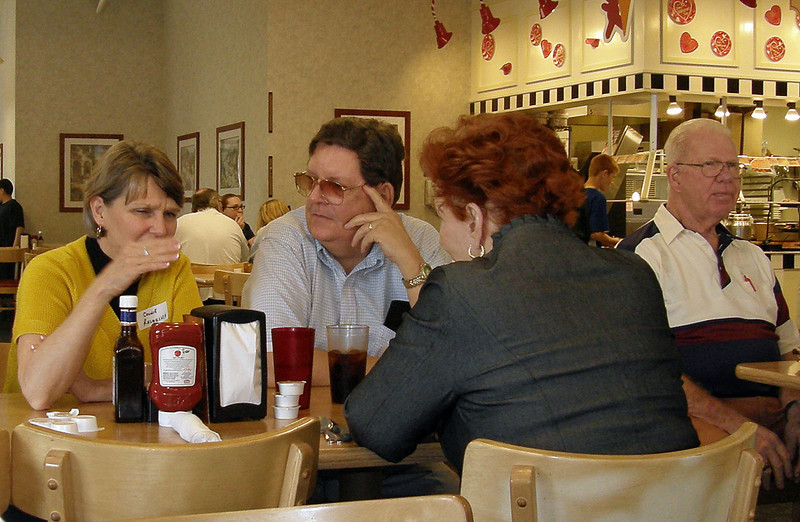 <b><i>From February 6, 2010:</i></b>  Connie Rasmussen (left) is executive director of the Chadron State College Foundation.  She's a friendly and familiar face for Chadron Area Reunion (CAR) attendees.  Here she visits with folks at a February 2010 gathering in Mesa.