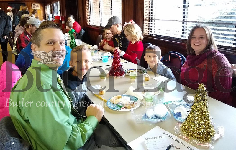 Brandt Reeder, left, and his twin brother, Easton, attend Breakfast with Santa on Saturday, Dec. 7, 2019, at the Butler Township Park Building. Their father, Jim, and mother, Jenna, said this was the first breakfast with Santa for their 6-year-old sons. Donna Sybert/Butler Eagle