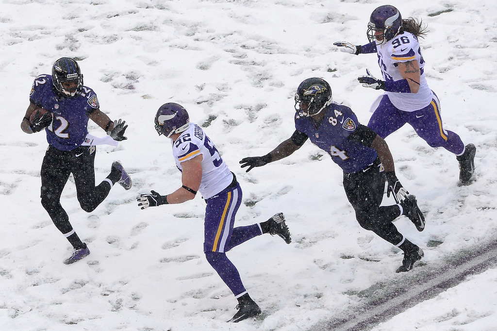 . Jacoby Jones #12 of the Baltimore Ravens returns a punt in the second quarter against the Minnesota Vikings at M&T Bank Stadium on December 8, 2013 in Baltimore, Maryland. (Photo by Patrick Smith/Getty Images)