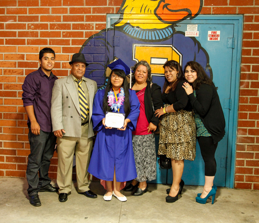 . Alicia Lizbeth Lozano is surrounded by the wings of the Poly Parrot and her family. Present are father, Francisco Lozano, mother, Juanita Lozano, sister, Monica Lozano, brother, Juan Lozano and sister in law, Laura Solano, at John H Francis Polytechnic High School, Sun Valley, Calif., June 7, 2013. Photo: Lynn Levitt.