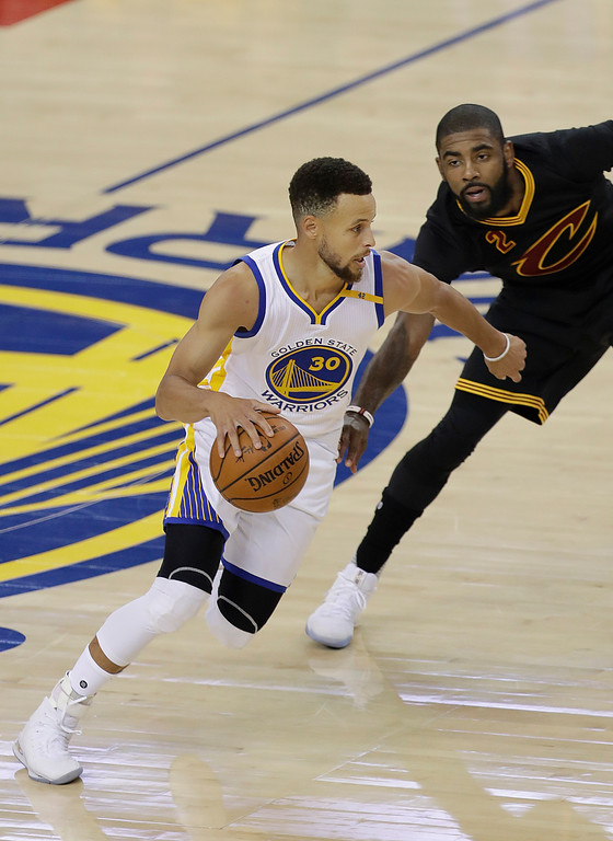 . Golden State Warriors guard Stephen Curry (30) dribbles against Cleveland Cavaliers guard Kyrie Irving (2) during the first half of Game 2 of basketball\'s NBA Finals in Oakland, Calif., Sunday, June 4, 2017. (AP Photo/Marcio Jose Sanchez)