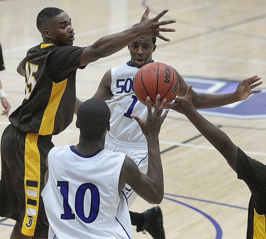 . Denver South center Ibrahim Sylla (10) tried to get the ball to teammate Tyson Purifoy (1) in the second half.   Photo By Karl Gehring/The Denver Post