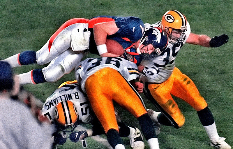 . The Broncos converted two turnovers to take a 17-7 lead in the second quarter before the Packers cut the score to 17-14 at halftime. Green Bay kept pace with Denver in the second half before tying the game with 13:32 remaining. Both defenses stiffened until Broncos running back Terrell Davis scored the go-ahead touchdown with 1:45 left. Denver beat the Packers 31-24.   Denver Broncos quarterback John Elway dives over Green Bay Packers defenders for a first down during the third quarter of the Super Bowl on Jan. 25, 1998, in San Diego. Elway all but announced his retirement Saturday in an interview with Denver TV station KCNC in Pebble Beach, Calif., where he was playing in a golf tournament. (AP Photo/Milwaukee Journal Sentinel, Jim Gehrz)
