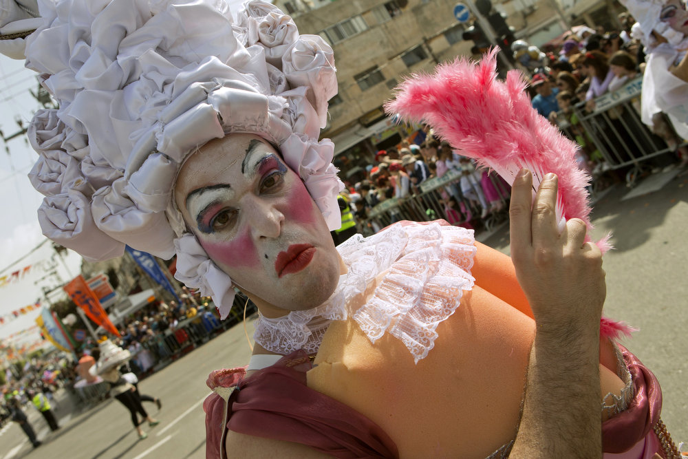 . An Israeli man takes part in a parade to celebrate the Jewish holiday of Purim in the central Israeli city of Netanya on February 24, 2013. The carnival-like Purim holiday is celebrated with parades and costume parties to commemorate the deliverance of the Jewish people from a plot to exterminate them in the ancient Persian empire 2,500 years ago, as recorded in the Biblical Book of Esther. JACK GUEZ/AFP/Getty Images