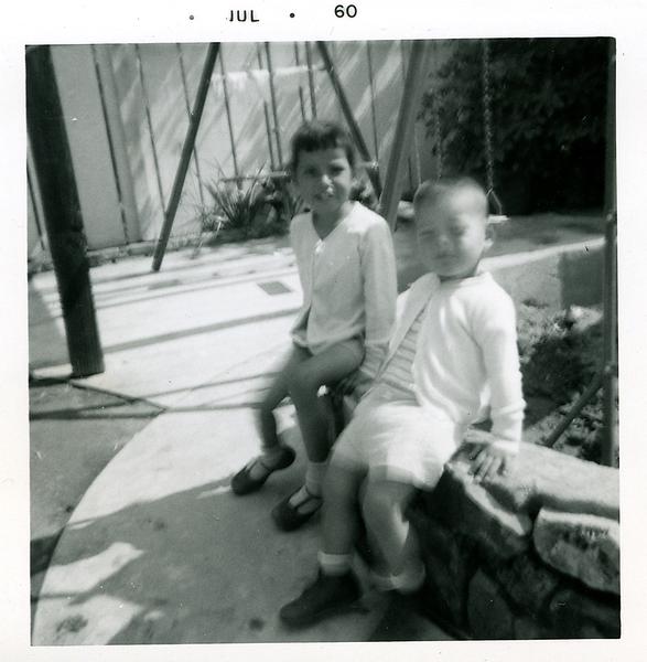 1960-07-michaela-n-joe-by-the-swings.png