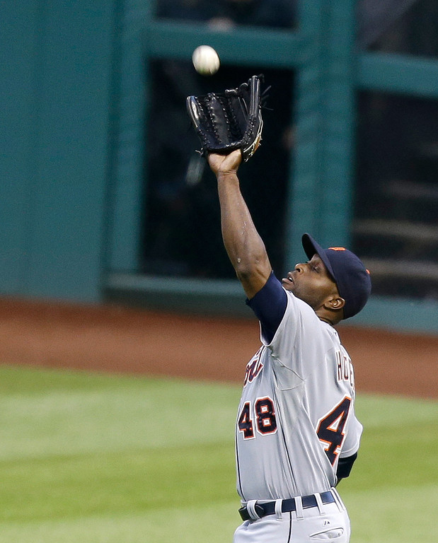 . Detroit Tigers\' Torii Hunter reaches for a fly ball hit by Cleveland Indians\' Mike Aviles in the fourth inning of a baseball game, Monday, May 19, 2014, in Cleveland. Aviles was out. (AP Photo/Tony Dejak)