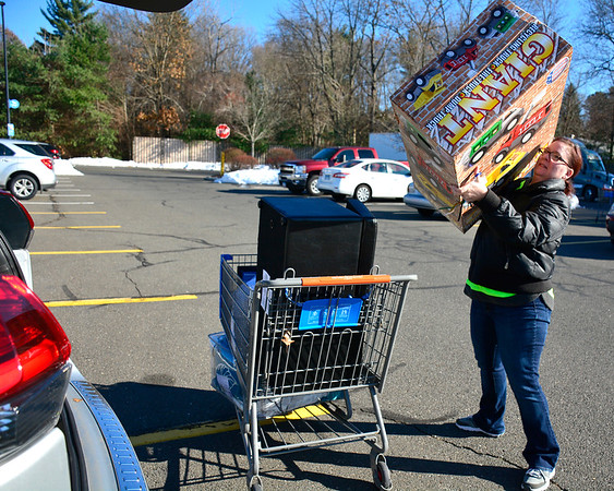 11/23/2018 Mike Orazzi | Staff Jennifer Gavin with items she bought at the Bristol Walmart on Black Friday.