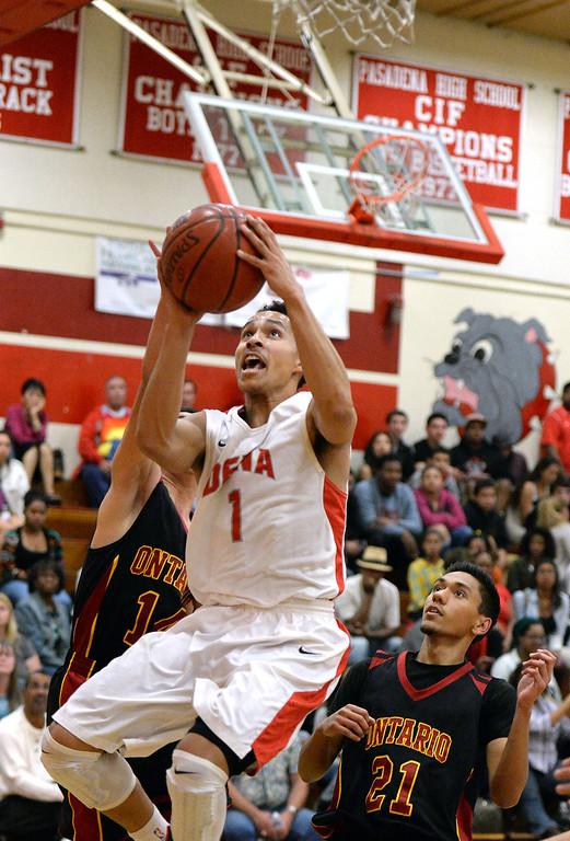 . Pasadena\'s Ajon Efferson (1) drives to the basket against Ontario in the first half of a prep playoff game at Pasadena High School in Pasadena, Calif., on Friday, Feb.21, 2014. (Keith Birmingham Pasadena Star-News)