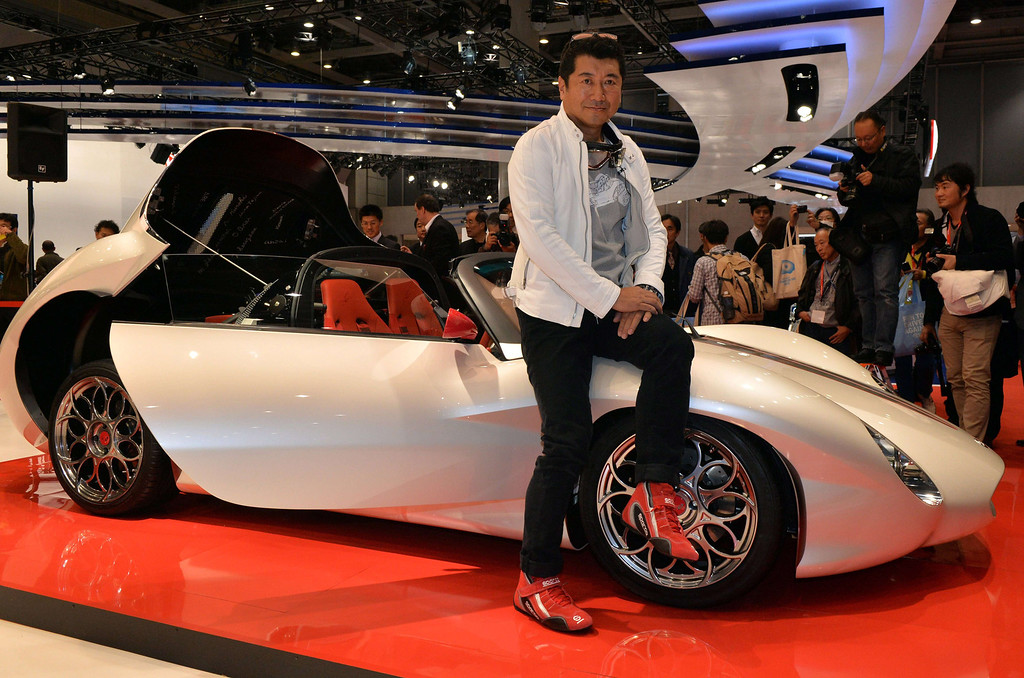 """. Japanese car designer Ken Okuyama, who designed a Ferrari car, displays the new lightweight sports car \""""Kode 9\"""", equipped with a 2.0-litter super-charged engine to drive two-seater body which will be priced 12 million yen (120,000 USD) at the press preview of the Tokyo Motor Show in Tokyo on November 20, 2013. The  43rd Tokyo Motor Show runs until December 1 and features 177 exhibitors including parts suppliers from a dozen countries. .   AFP PHOTO / Yoshikazu TSUNO/AFP/Getty Images"""