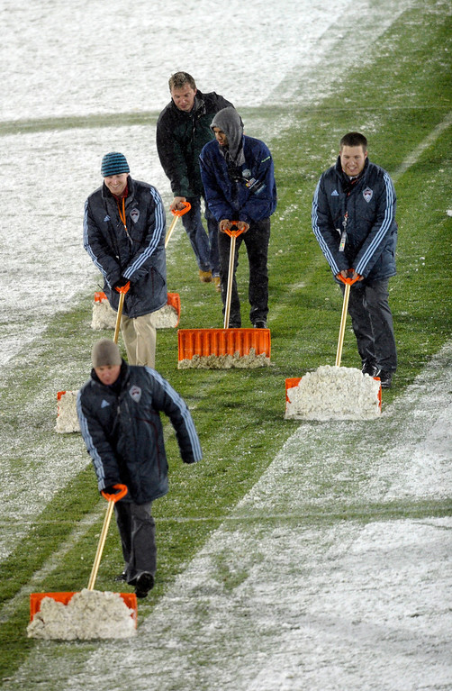 . COMMERCE CITY, CO. - MARCH 22: A crew of shovelers cleared midfield prior to the game. The U.S. Men\'s National Soccer Team hosted Costa Rica Friday night, March 22, 2013 in a FIFA World Cup qualifier at Dick\'s Sporting Goods Park in Commerce City.  (Photo By Karl Gehring/The Denver Post)