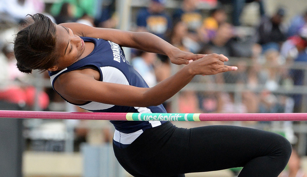 . Redland\'s Alisha Edwards competes in the division 2 high jump during the CIF Southern Section track and final Championships at Cerritos College in Norwalk, Calif., Saturday, May 24, 2014.   (Keith Birmingham/Pasadena Star-News)