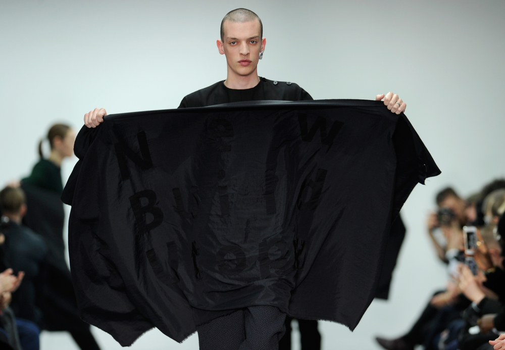 . A model walks the runway at the Matthew Miller show during The London Collections: Men Autumn/Winter 2014 on January 6, 2014 in London, England.  (Stuart C. Wilson/Getty Images)