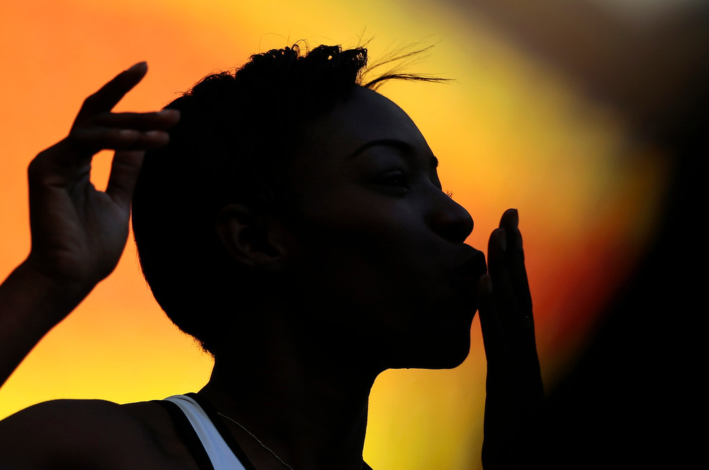 . Ivory Coast\'s Murielle Ahoure blows a kiss to television cameras before competing in a men\'s 100-meter heat at the World Athletics Championships in the Luzhniki stadium in Moscow, Russia, Sunday, Aug. 11, 2013. (AP Photo/Ivan Sekretarev)