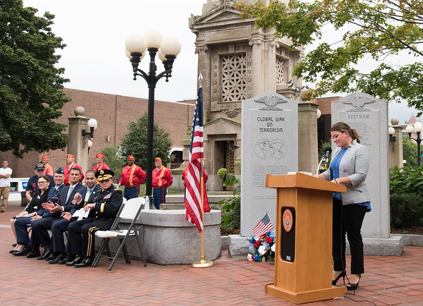 09/11/18 Wesley Bunnell | Staff New Britain unveiled its newest monument in Central Park which is dedicated to the War on Terror following the 9/11 attacks. Mayor Erin Stewart speaks as fellow guest speakers sit to the left and the Marine Corps League Honor Guard stands in the background.