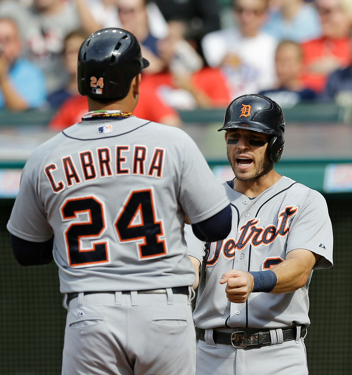 . Detroit Tigers\' Ian Kinsler, right, congratulates Miguel Cabrera after Cabrera hit a two-run home run off Cleveland Indians starting pitcher Corey Kluber in the first inning of a baseball game, Monday, Sept. 1, 2014, in Cleveland. Kinsler scored on the play. (AP Photo/Tony Dejak)