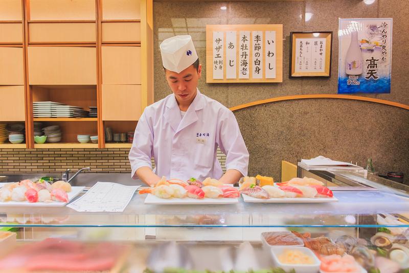 Sushi chef in Tsukiji. Editorial credit: PANUWAT YUTKITSATAPHON / Shutterstock.com
