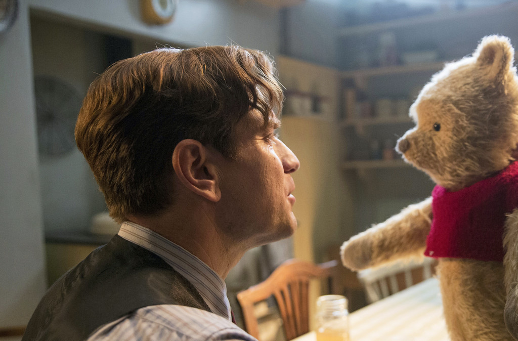 ". Ewan McGregor and Winnie the Pooh share a scene from ""Christopher Robin.\"" The movie is in theaters Aug. 3. (Laurie Sparham/Disney via AP)"