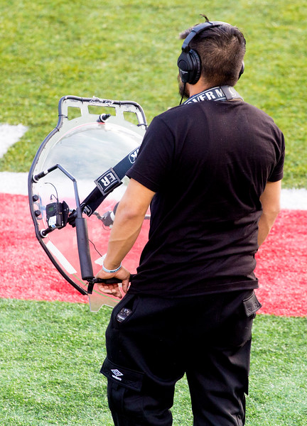 The CBS field sound man with his parabolic receiver