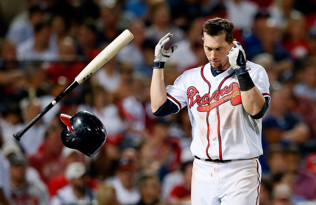 . ATLANTA, GA - OCTOBER 04: Chris Johnson #23 of the Atlanta Braves reacts after striking out in the eighth inning against the Los Angeles Dodgers during Game Two of the National League Division Series at Turner Field on October 4, 2013 in Atlanta, Georgia.  (Photo by Kevin C. Cox/Getty Images)