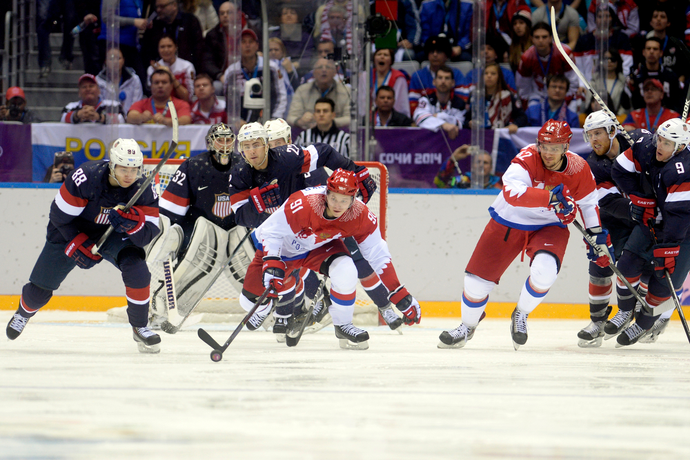 . Vladimir Tarasenko (91) of the Russia loses his balance against the U.S.A. during  the third period of the U.S.A.\'s shootout-win at Bolshoy arena. Sochi 2014 Winter Olympics on Saturday, February 15, 2014. (Photo by AAron Ontiveroz/The Denver Post)