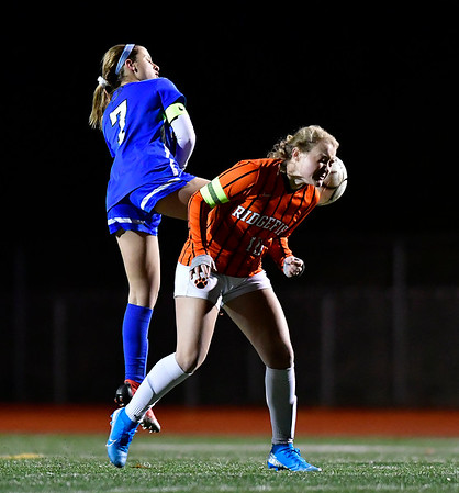 11/19/2019 Mike Orazzi | StaffrSouthington High School's Emma Panarella (7) and Ridgfield's Megan Klosowski (10) during the Class LL Semifinal Girls Soccer match at Naugatuck High School Tuesday night. Southington advanced to the final 1-0.r