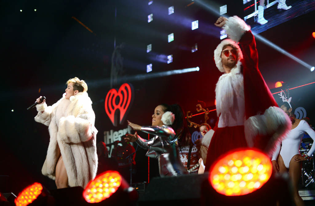 ". Miley Cyrus sings ""Party in the USA\"" with her group at Xcel Energy Center in St. Paul, Tuesday, December 10, 2013. (Pioneer Press: Chris Polydoroff)"