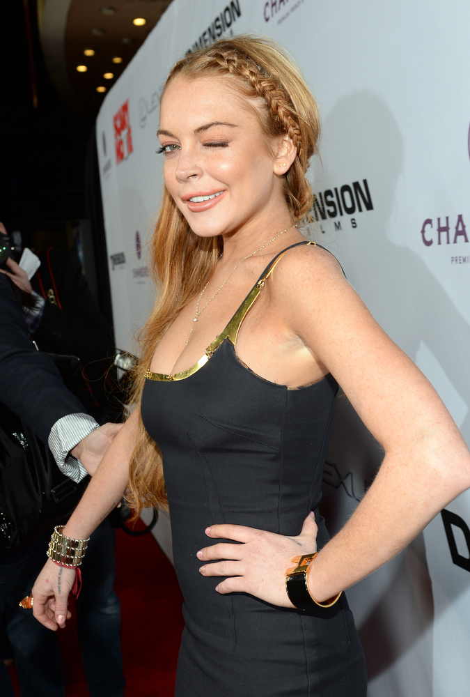 ". Actress Lindsay Lohan arrives for the premiere of Dimension Films\' ""Scary Movie 5\"" at ArcLight Cinemas Cinerama Dome on April 11, 2013 in Hollywood, California.  (Photo by Michael Buckner/Getty Images)"