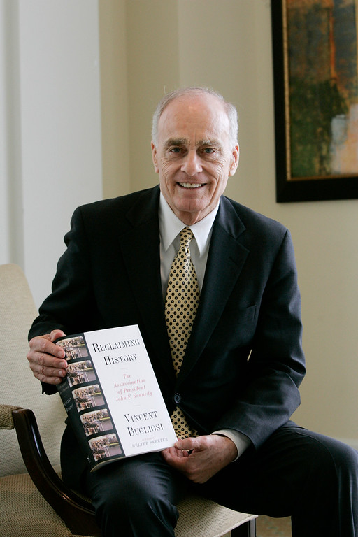". Vincent Bugliosi holds a copy of his book, ""Reclaiming History, The Assassination of President John, F. Kennedy\"" during a book promotion event in Dallas, Thursday, May 24, 2007. Bugliosi, the prosecutor in the Charles Manson trial, also authored \""Helter Skelter: The true story of the Manson murders,\"". (AP Photo/Tony Gutierrez)"