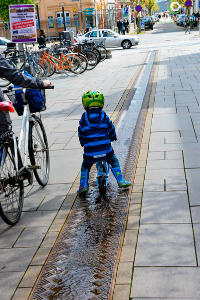 Child riding in water fountian.jpg