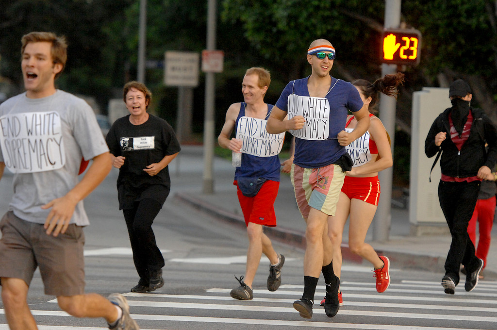 """. Protesters jog through Westwood during a \""""Smash White Supremacy Fun Run,\"""" Thursday, July 18, 2013. (Michael Owen Baker/L.A. Daily News)"""