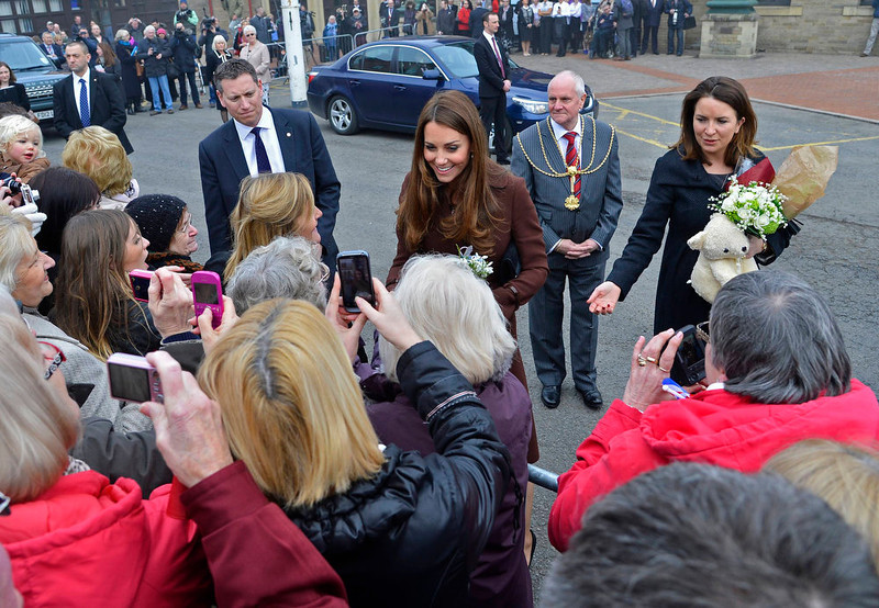 . Britain\'s Catherine, Duchess of Cambridge (C) speaks with well-wishers as she leaves the National Fishing Heritage Centre in Grimsby, in northern England March 5, 2013. REUTERS/Toby Melville