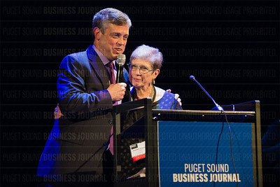 Emory Thomas, publisher of the Puget Sound Business Journal, congratulates Louise Chernin, president and CEO of the Greater Seattle Business Association, after she was presented the Lifetime Achievement Award at the PSBJ's The Business Of Pride event at the Paramount Theatre in Seattle on Thursday, May 26, 2016. (BUSINESS JOURNAL PHOTO | Dan DeLong)