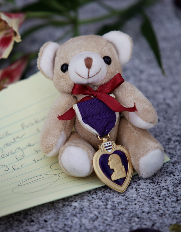 """. A bear with a Purple Heart and a hand written note was left at a makeshift memorial for slain Santa Cruz police officers, detective <a href=\""""http://www.santacruzsentinel.com/localnews/ci_22676928/loran-butch-baker-28-year-veteran-leaves-legacy\"""">Sgt. Loran \""""Butch\"""" Baker</a> and detective <a href=\""""http://www.santacruzsentinel.com/localnews/ci_22676931/santa-cruz-police-detective-elizabeth-butler-policing-was\"""">Elizabeth Butler</a> in front of the police department in Santa Cruz, Calif. on Wednesday, Feb. 27, 2013. The pair were <a href=\""""http://www.santacruzsentinel.com/localnews/ci_22674808/breaking-2-officers-1-suspect-shot-santa-cruz\"""">gunned down yesterday</a while investigating a possible domestic violence or sexual assault when a suspect fired at them. The gunman, Jeremy Peter Goulet, was later gunned down when he exchanged gunfire with police during a manhunt. (Gary Reyes/ Staff)"""