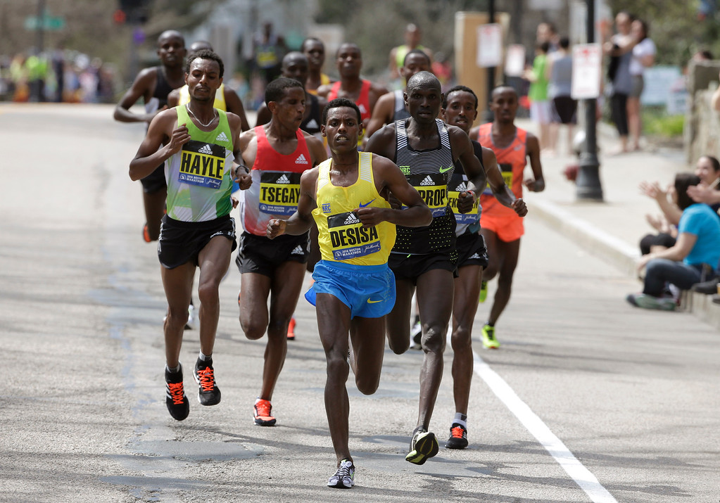 . Lemi Berhanu Hayle, left, and Lelisa Desisa, front, both of Ethiopia, run through Newton, Mass., during the 120th Boston Marathon on Monday, April 18, 2016. (AP Photo/Steven Senne)