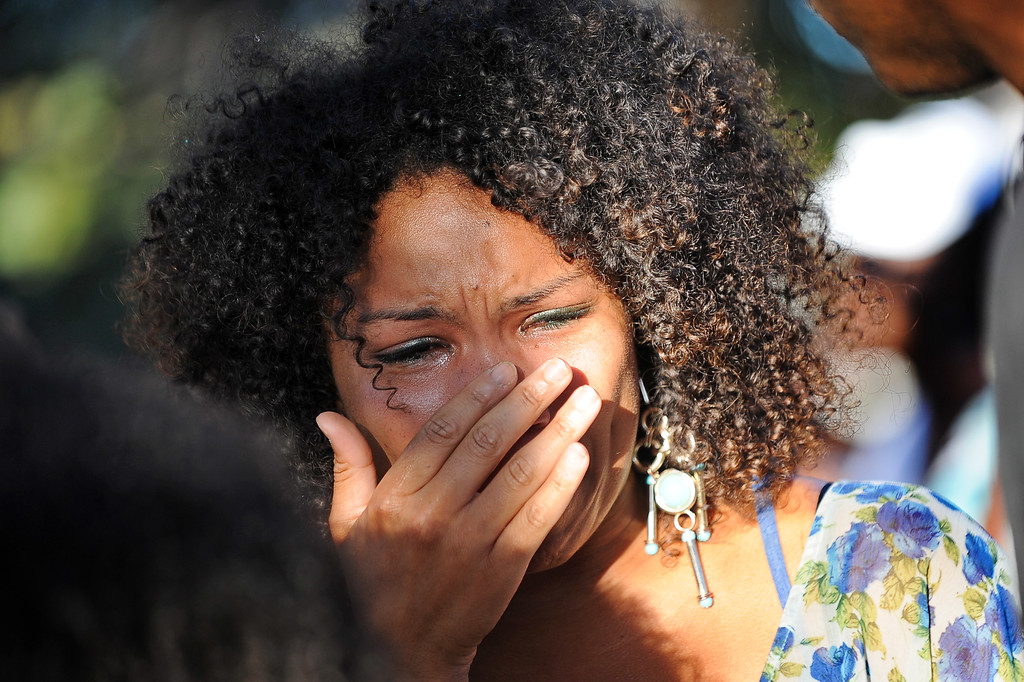 . Myishia Brown wipes away tears during a prayer rally at Leimert Park in the aftermath of George Zimmerman\'s acquittal at his murder trial for the slaying of Trayvon Martin July 15, 2013.  A group of protestors split off from the rally and made their way down Crenshaw Blvd. Monday night.(Andy Holzman/Los Angeles Daily News)