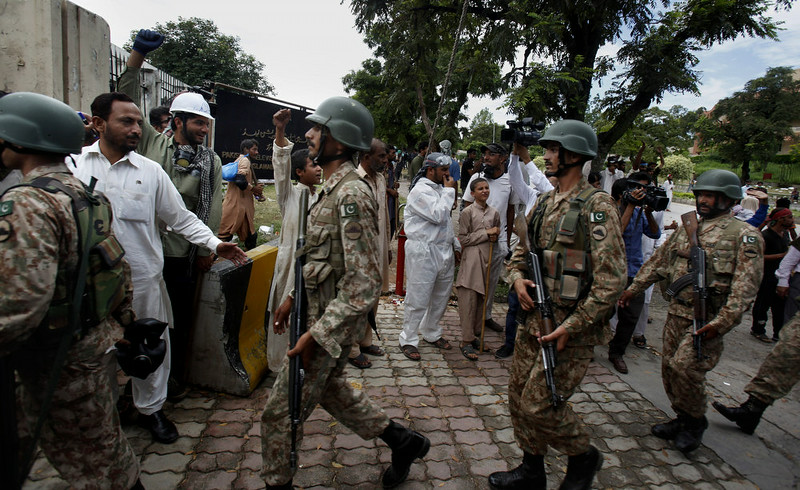 . Pakistani troops arrive to take control of the state television building occupied by protesters in Islamabad, Pakistan on Monday, Sept. 1, 2014. Anti-government protesters and Pakistani police have clashed once again as the demonstrators pushed into a sprawling government complex in the country\'s capital in an effort to try to reach the prime minister\'s official residence. (AP Photo/Anjum Naveed)