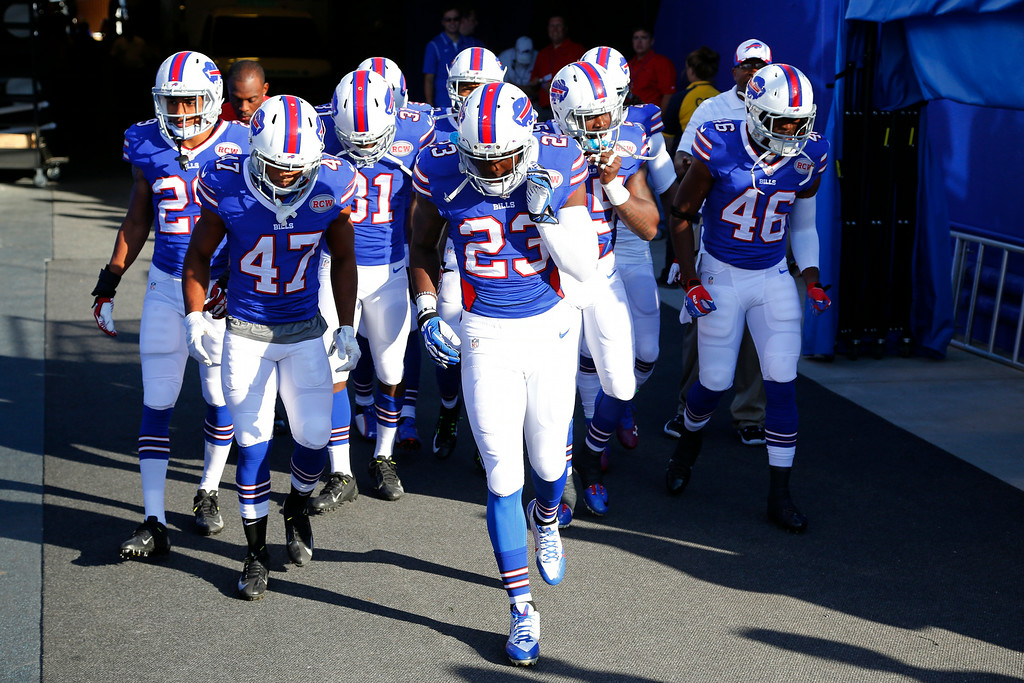 . Buffalo Bills players take the field for warm ups before a preseason NFL football game against the Detroit Lions, Thursday, Aug. 28, 2014, in Orchard Park, N.Y. (AP Photo/Bill Wippert)