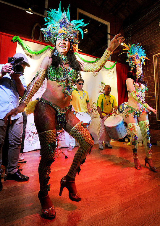 . Alessanda Comoro and Isabella Grosso of Oya Brazil Samba Show perform for Brazilian fans at  Gauchos Village, a Brazilian style restaurant in Glendale to party and watch live television broadcast of World Cup action between Brazil  and Croatia in the World Cup Thursday, June 12, 2014.(Photo by Walt Mancini/Pasadena Star-News)