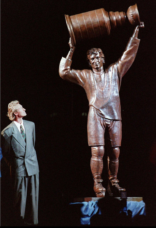 . FILE--Wayne Gretzky glances up at statue of himself at Northlands Coliseum in 1989 after the unveiling in Edmonton, Alberta, Canada.  Gretzky, the hockey great who failed to win a Stanley Cup in Los Angeles, was traded to the St. Louis Blues on Tuesday Feb. 27, 1996  ending weeks of rumor and speculation about his future.(AP Photo/Dave Buston)