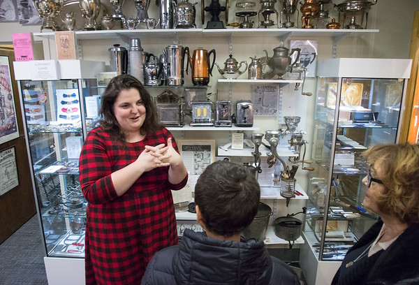 02/13/20 Wesley Bunnell | StaffrrNew Britain Industrial Museum Director Sophie Huget shows Stanley Lawson, age 14, and his grandmother Gail Brooks an exhibit on toasters in the museum.