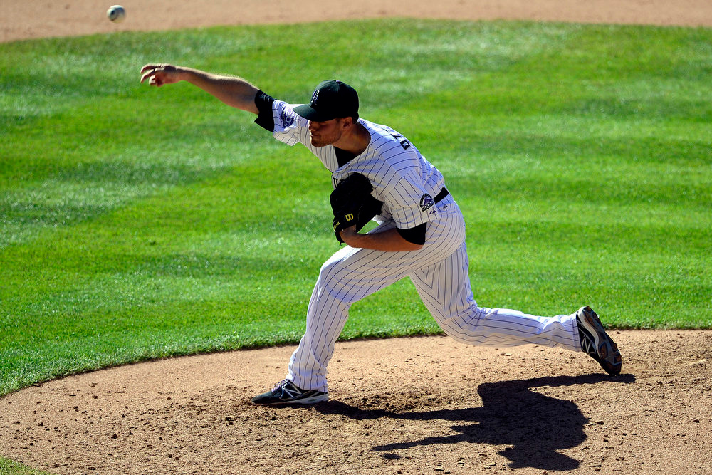 . Colorado Rockies pitcher Adam Ottavino (0) pitches to the Los Angeles Dodgers during the ninth inning of the Rockies\' 7-2 win in Denver. The Colorado Rockies hosted the Los Angeles Dodgers at Coors Field. (Photo by AAron Ontiveroz/The Denver Post)