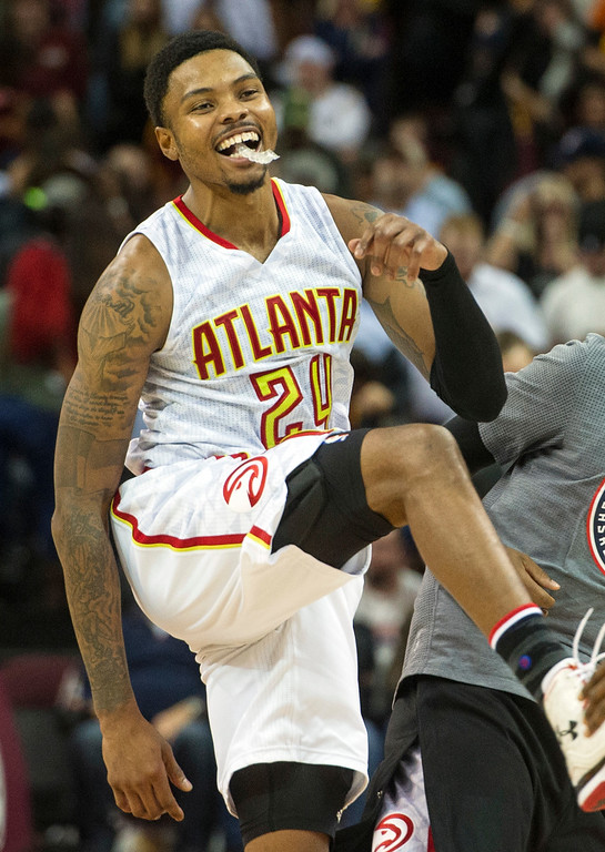 . Atlanta Hawks\' Kent Bazemore (24) is all smiles after defeating the Cleveland Cavaliers 110-106 in an NBA basketball game in Cleveland, Tuesday, Nov. 8, 2016. (AP Photo/Phil Long)