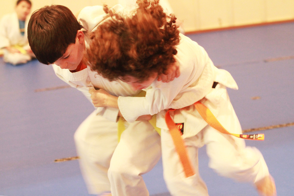 . Zach Meyers, 10, left, and Bennett Rosenberg, 11, practice a takedown during a judo-jujitsu class for students from the ages of 7 to 16 at Grant Park in Los Altos on Monday, Feb. 25, 2013. The Monday-Thursday classes, taught by Sensei Eddie Gearhart, are offered through the Los Altos Recreation Department. For more information, visit www.zentaijudojujitsu.org. (Kirstina Sangsahachart/ Daily News)