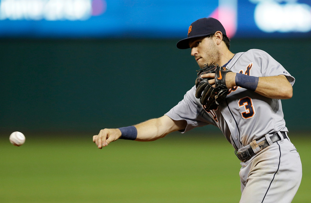 . Detroit Tigers\' Ian Kinsler throws out Cleveland Indians\' David Murphy in the seventh inning of a baseball game, Friday, June 20, 2014, in Cleveland. (AP Photo/Tony Dejak)