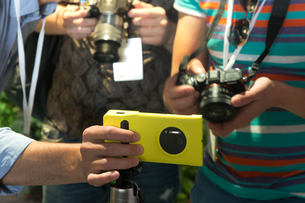 . Journalists photograph a Lumia 1020 at its introduction, in New York,  Thursday, July 11, 2013. (AP Photo/Richard Drew)