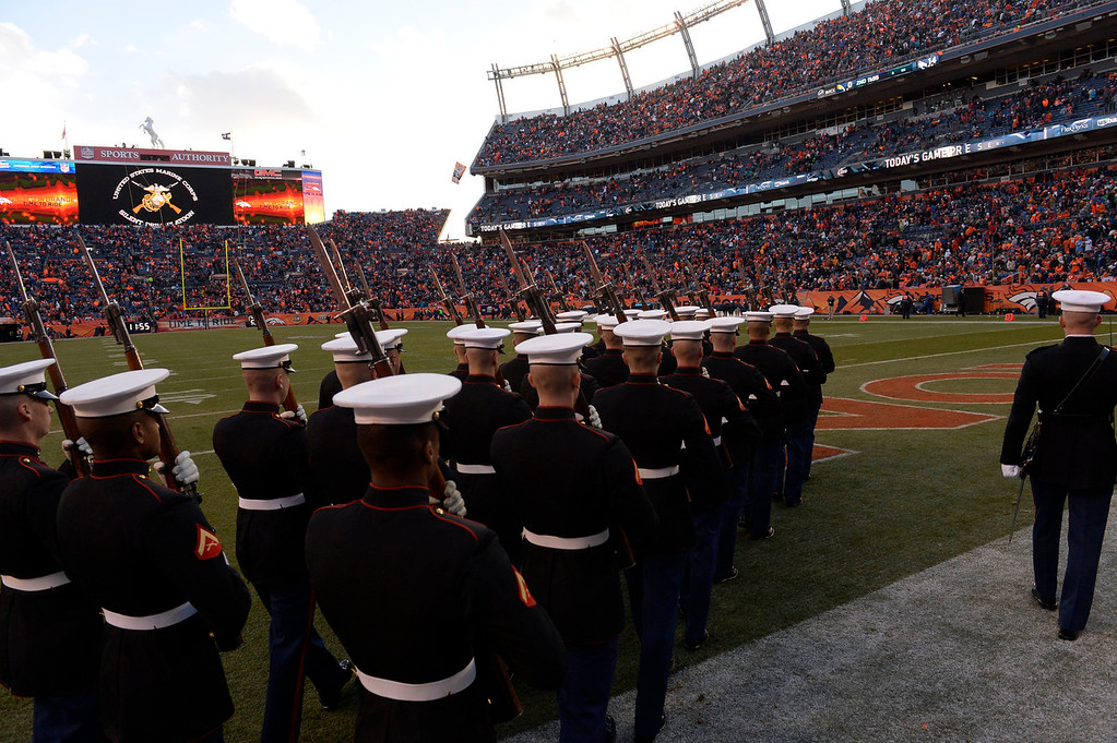 . Marines take the field for a halftime ceremony. The Denver Broncos take on the San Diego Chargers at Sports Authority Field at Mile High in Denver on January 12, 2014. (Photo by Craig F. Walker/The Denver Post)