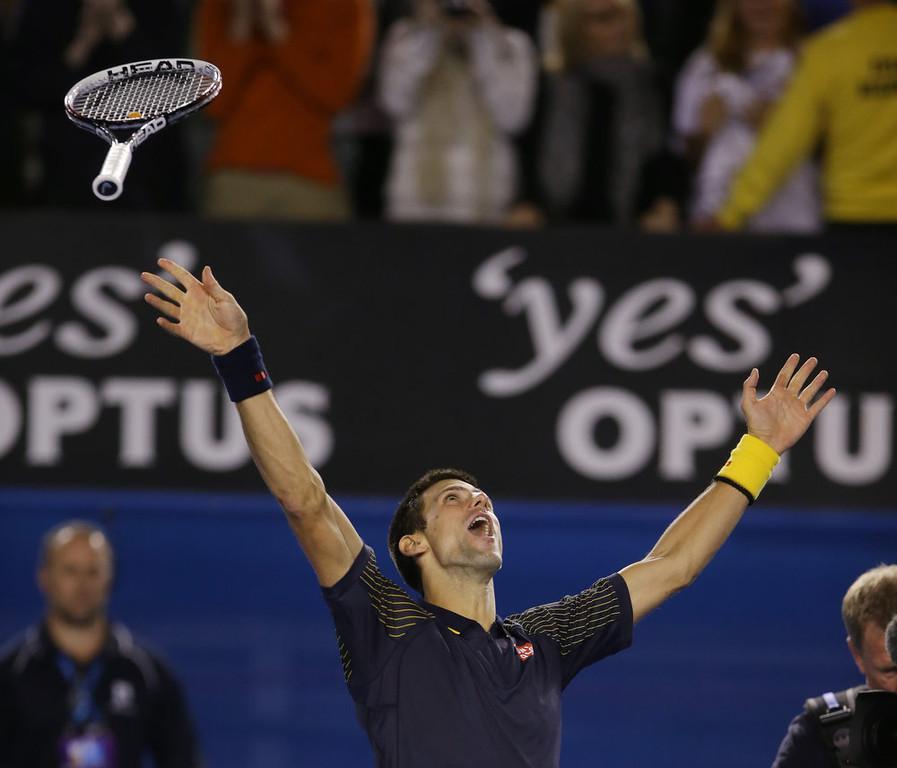 . Serbia\'s Novak Djokovic celebrates his win over Britain\'s Andy Murray in the men\'s final at the Australian Open tennis championship in Melbourne, Australia, Sunday, Jan. 27, 2013. (AP Photo/Dita Alangkara)