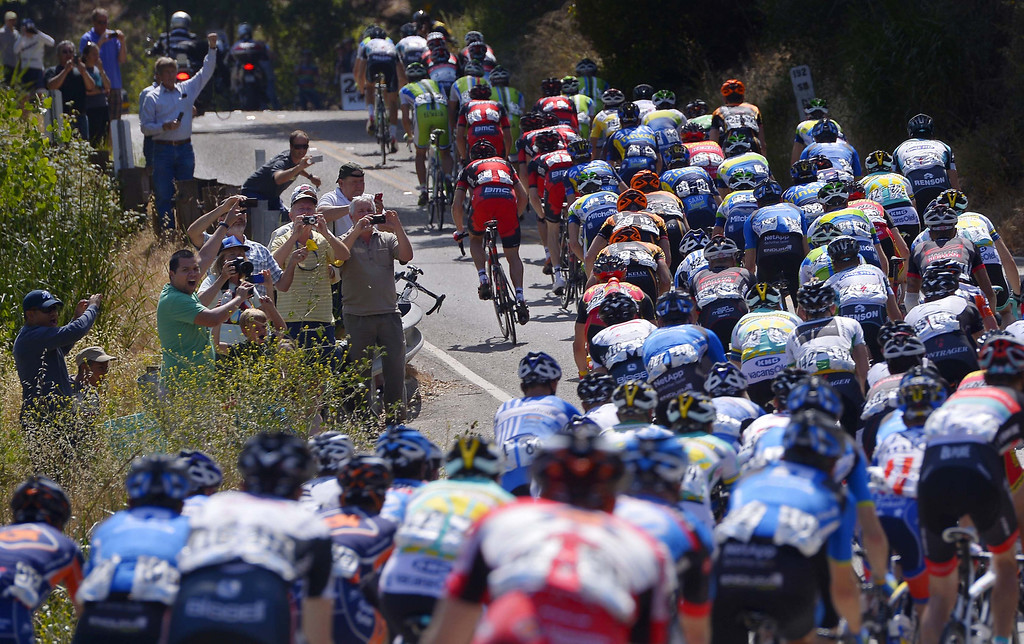 . The peloton rides past spectators during the fourth stage of the Tour of California cycling race, Wednesday, May 15, 2013, in Santa Barbara, Calif. (AP Photo/Mark J. Terrill)
