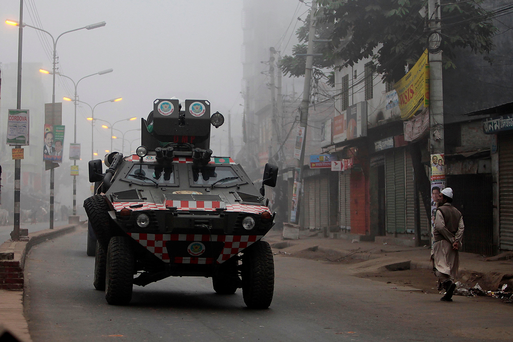 Description of . A Bangladeshi security vehicle patrols during a half day strike called by Islamic political parties in Dhaka, Bangladesh, on Thursday, Dec. 20, 2012. More than two dozen Islamic parties in Bangladesh want the country to be governed by Sharia, or Islamic law. A coalition of five leftist parties want the Islamic parties to be banned because they oppose the constitutional provision that says Bangladesh be governed by secular law. (AP Photo/A.M. Ahad)