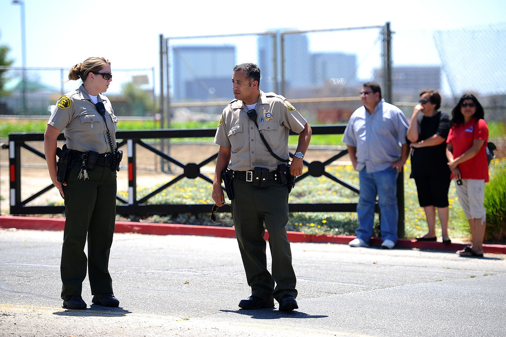 . Sheriff deputies keep people away from Pierce College May 30, 2014 in Woodland Hills.  A report of a suicidal man with a gun on campus created a lockdown situiation around noon.  The man was later found at Canoga Bowl.(Andy Holzman/Los Angeles Daily News)